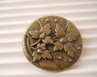 BUTTONS:  Button, brass, floral, reproduction, just over 1 inch.