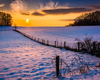 Sunset over a fence in a snow covered farm field in rural Carroll County, Maryland. - Winter Landscape Fine Art Print or Wrapped Canvas
