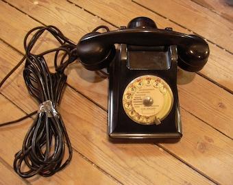 Vintage rotary dial phone in Bakelite, France 50s.