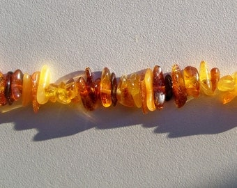 """Full 16"""" strand of natural polished Baltic amber chips"""