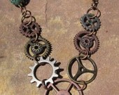 Long Steampunk Gears Necklace. Mixed metals and Blue Beads.