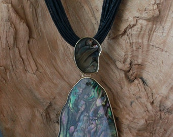 Exquisite ABALONE pendant set in Gold filled Brass,hanging from a MULTI Strand LEATHER Necklace.nice!