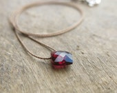 Minimalist necklace with a small faceted garnet, rhombus shaped. Everyday necklace with a small faceted garnet briolette. January birthstone