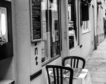 Paris Cafe,Paris Photography.Charming paris cafe near Sorbonne with one sidewalk table for two in black and white