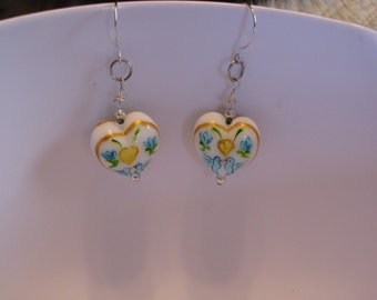 Round Amish glass heart earrings.