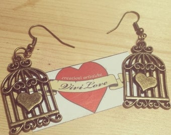 vintage earrings cage made of antique bronze old style heart freedom swallow