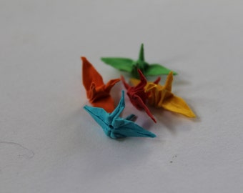 Five mini cranes in red, orange, yellow, green and blue