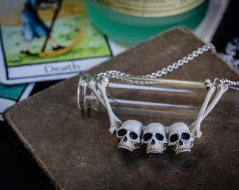 Skull and bones danse macabre necklace inspired by medieval plague