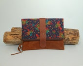 fold over clutch, pretty flowers on navy blue with brown leather