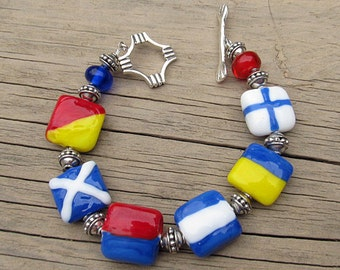 Custom Made Nautical signal flag lampwork glass bracelet with sterling silver