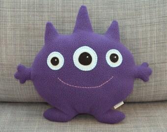 Purple Three-Eyed Stuffed Monster, Jordan