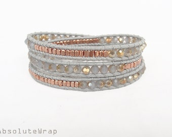Gray gold crystal wrap bracelet with copper plated beads on soft polyester cord