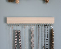 Set of three natural wood (with gold/brass or silver/nickel) display racks: two for necklaces and bracelets, one for earrings (wall hanging)