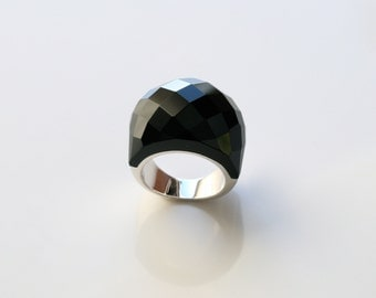 Gorgeous sterling silver ring in black onyx on a dome design. Modern Multi-faceted onyx ring.