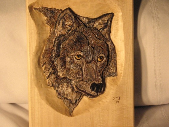 Relief carving of a wolf portrait