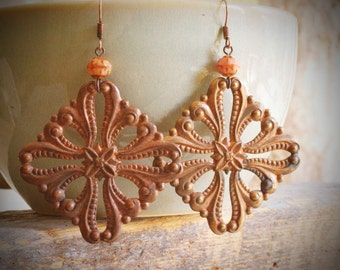rococo vintage copper filigree stamping earrings and salmon pink czech glass on antiqued copper by val b.
