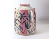 Coffee Canister with Red Orange Stripes and Flower Silhouettes