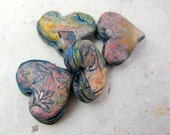Rough encrusted strata hearts in polymer with turquoise, pink, and blue accents