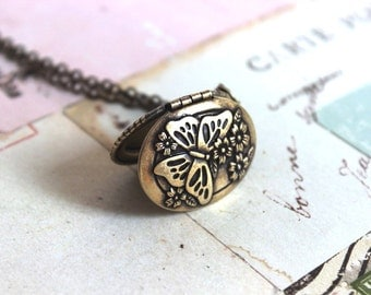 butterfly oval. locket necklace. brass ox jewelry with floral and vine pattern