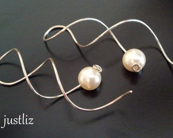 Simple sterling earrings with faux pearl that twist on