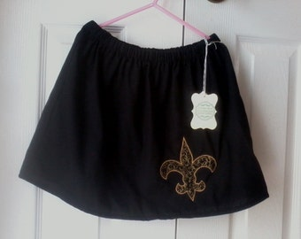 Girl's lined Saints inspired skirt, size 6/7, embroidered in  gold edge with fleur de lis of black with gold scrolls
