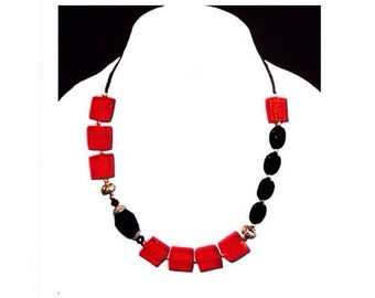 Black, red and silver chunky beaded Brighton style necklace has the trendy geometric style.
