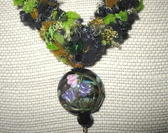 Handknit designer yarn necklace with lampwork focal bead and Swarovski crystal accents