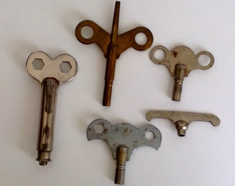 collection five assorted antique clock keys