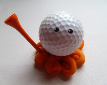 Custom Golfing Golf Ball Octopus Choose your Leg Colors Shown in Orange and Translucent Swirl with Orange Golf Tee