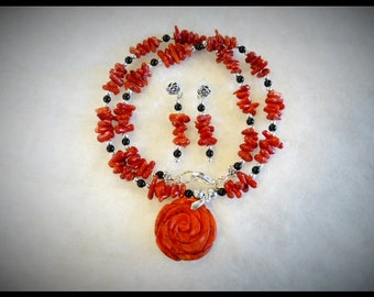 A Pretty Red Corel Necklace with matching earrings. one of a kind and hand made