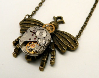 Steampunk jewelry. Steampunk bee with a watch pendant necklace.