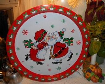 Vintage Round Metal Christmas Serving Tray Santa and Mrs Claus Smooching