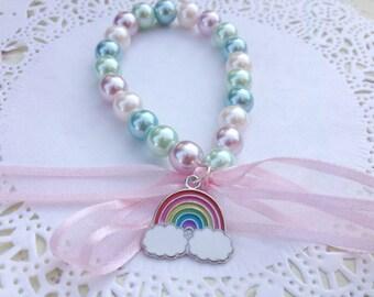 Rainbow  - Pearl bead, ribbon and charm bracelet - pink