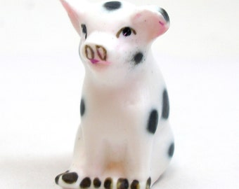 Piggy figurine, Seated white PIG with black spots.