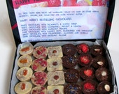 A box of 24 raw vegan chocolates made by Happy Herbi. Only the bestsellers. Organic.  No gluten added