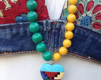Color block long necklace with colored jade and ethnic pendant