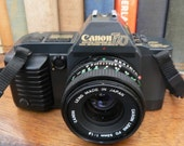 vintage camera ... CANON T70 35 mm camera with 50mm Canon FD LENS ...