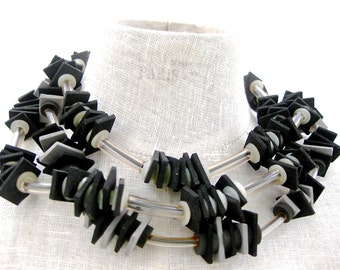 Black Rubber squares on short necklace, rubber tubing and toggle closing. Three strand necklace.