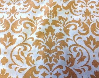 Damask print fabric gold on white