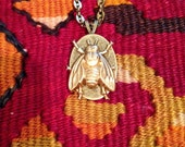 Very Downton Abbey bee pendant on a Gucci gold plated brass chain.