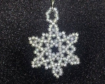 Frozen inspired necklace with beaded snowflake pendant on silver rope
