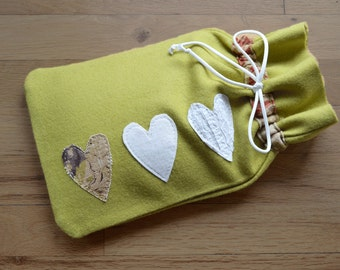 Hot water bottle cover in green felted wool with hearts