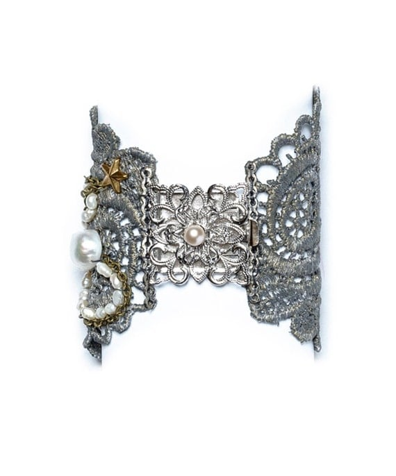 Silver lace beaded bracelet with a silver plated brooch, fresh water pearls and heart rhinestone.