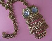 gold owl necklace. 1970's segmented / big eye bird pendant.