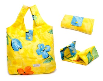 Foldable shopping tote. Yellow with flower patterns. 100% cotton  shopping bag