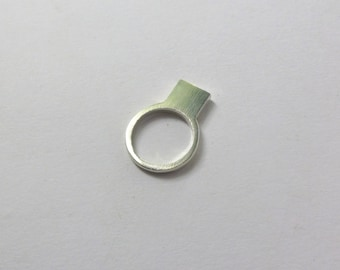 Sterling silver square ring.