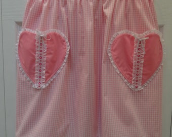 Apron , Pink Gingham  with pink heart shaped pockets.