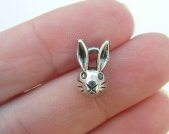 14 Rabbit charms antique silver tone A249