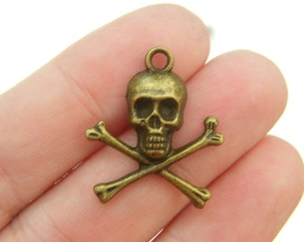 10 Skull and cross bones pendants antique bronze tone BC89