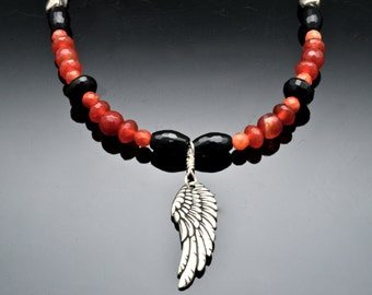 TAKE FLIGHT Necklace with beads of Carnelian and Black Onyx with Pewter Wing Pendant.  Creativity, Imagination, Root Chakra.